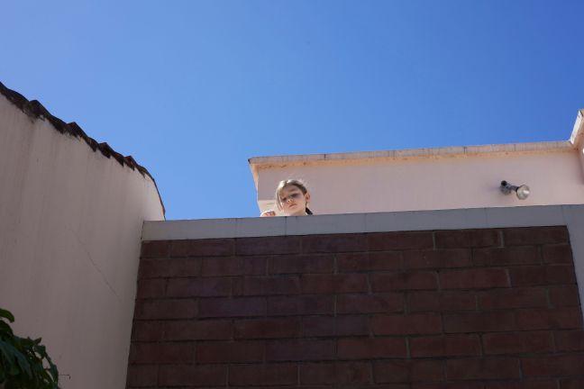abra peaking on balcony
