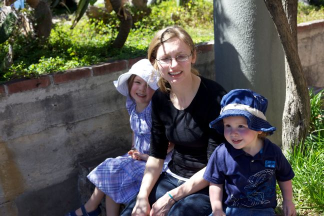 amber and kids on wall