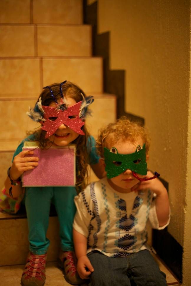 kids with mardi gras masks on