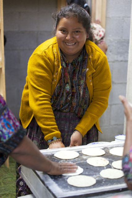 lady making tortillas