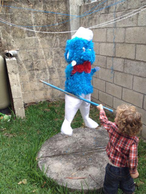 Ezra hitting pinata