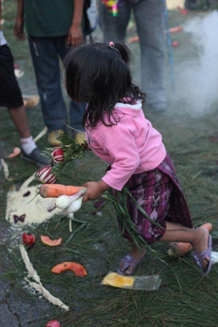 little girl with veggies