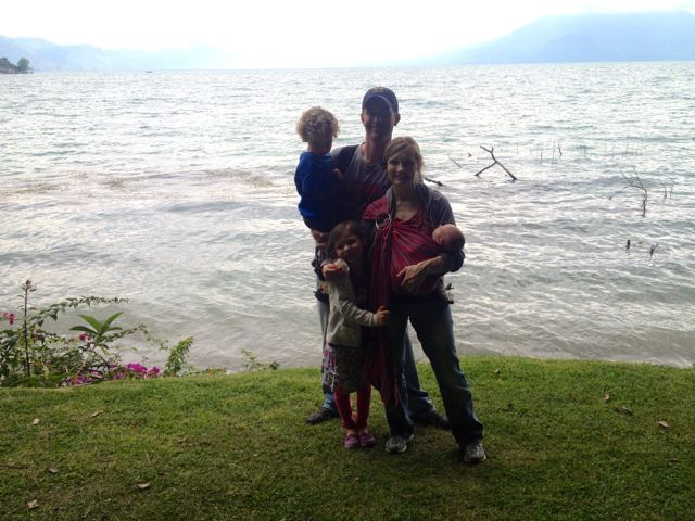 family photo in front of lake