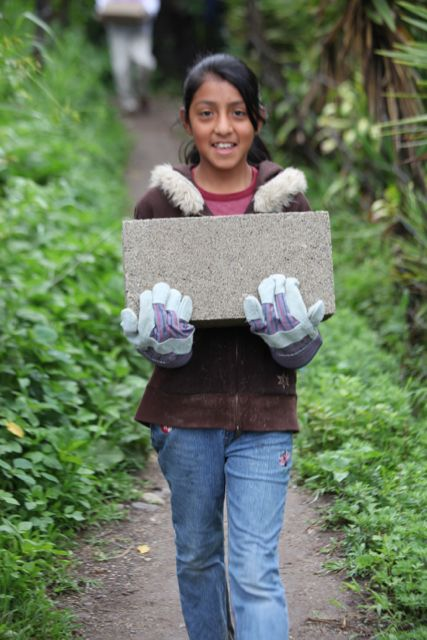 Jasmine carrying blocks