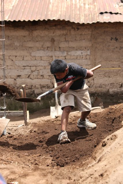 Oscar shoveling dirt