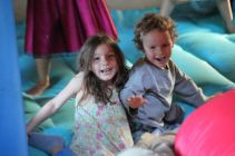 Abra and Ezra in the bounce house
