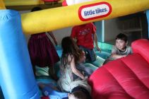 Kids playing the bounce house