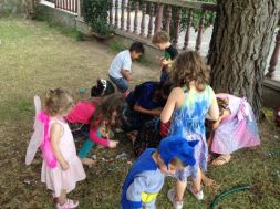 Kids scrambling for candy front he piñata