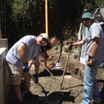Olive Branch crew mixing concrete